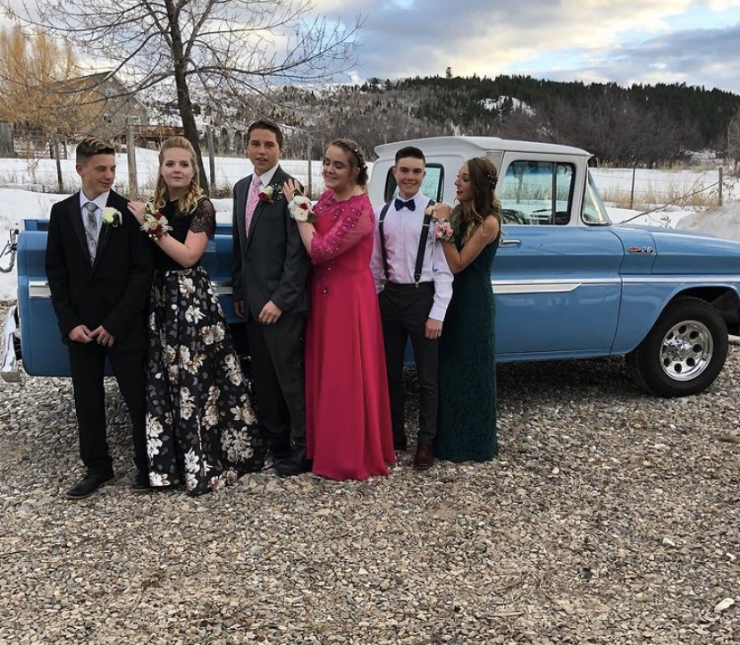 "TRUCKIN': Seniors pose for a picture at the 2019  prom. Aubree Pierson said, "" I love hanging out with my friends and getting all dressed up. It is especially fun to get ready with all my best friends before."" The group hopes to recreate the picture at this year's prom."