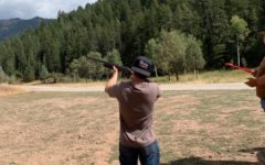 READY, AIM, FIRE: Senior JJ Hunsaker gets some shooting in, a favorite past time for many students in the valley. High demand for ammunition has made bullets of all kinds scare and expensive.