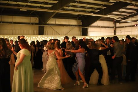 MOSH: Students get low on the dance floor, heating up while showing off their dance moves in a big circle.
