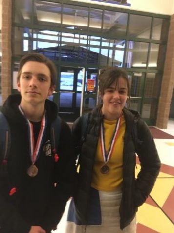 "STATE FUN: Sophomore Nathan Casperson and Junior Onikka Olsen smile after their state competition. ""We got these medals for getting 3rd place at a tournament because we are pretty cool,"" said Olsen."