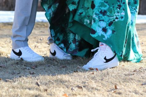 "PUMPED UP KICKS: Winston Green and Kendyll Rappleye sport matching shoes for their prom date. ""I liked matching because they were really comfortable. They were way better than wearing dress shoes. They were white and black, so I will wear them for many reasons even after prom,"" said Green."