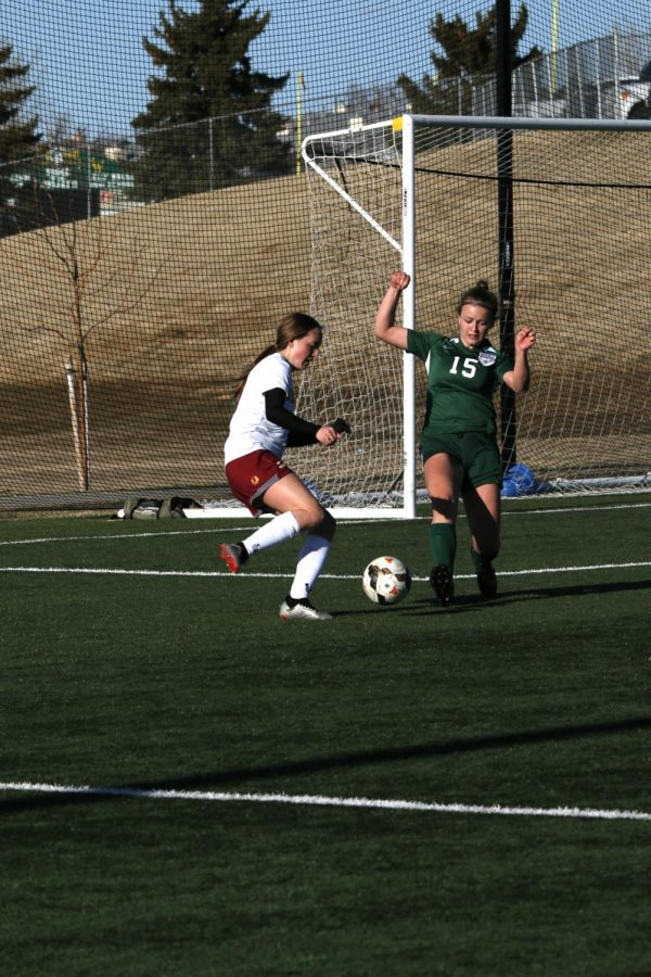 KICK IT: Senior Katie Robinson takes her shot against Kelly Walsh. The Lady Braves lost the contest 5-0.