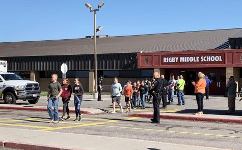 EXODUS: Students from Rigby Middle School calmly leave after a student shot and  wounded a custodian and two students on May 6th.