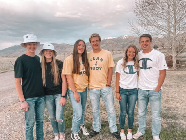 MATCHY MATCHY: Wearing traditional matching couple shirts, Zach Johnson, Whitnee Hale, Mia Hutchinson, Cache Bagley, Amber Milne, and Brant Nelson gather for a picture before going to MORP.