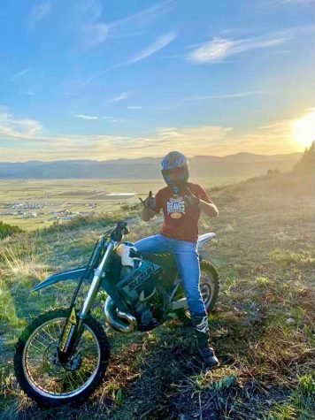 """DIRTY: Zac Patterson sits on top of Big Ridge astride his Suzuki 250. """"It wasn't too cold until the sun went down then it got chilly. And we definitely ran into quite a bit of snow, and because of that, we had to turn around."""" Riding his dirt bike is one of Patterson"""