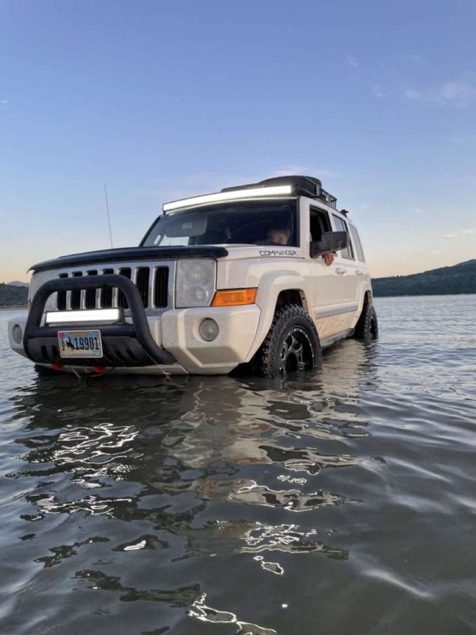 WADING: Orion Cottam and his Jeep Commander get wet. This is the second vehicle Cottam has owned.