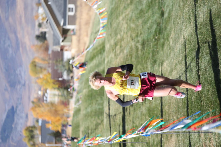 CRUSHIN IT: Peter Visser holds on to a massive lead at the state tournament in 2020. His form, his dedication, and his hard work toward becoming a better runner influences me to run more than I normally would, said freshman Habtamu Wetzel.