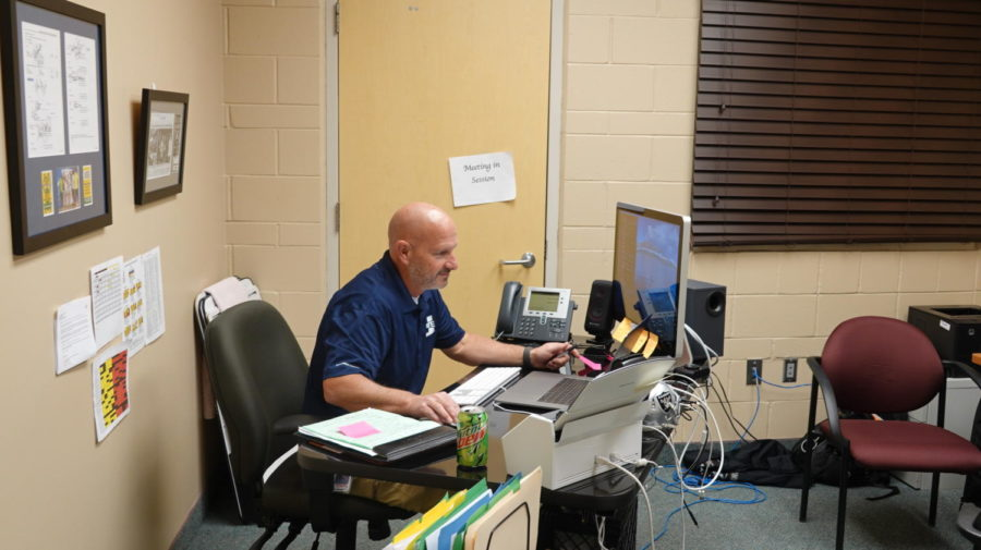 HARD+AT+WORK%3A+Compliance+Facilitator+Mr.+Brian+Toomer+sits+at+his+at+desk+determined+to++finish+all+of+his+work.+Toomer+started+here+after+serving+as+principal+at+Cokeville+High+School.+Outside+of+school%2C+I+really+enjoy+all+the+sports+this+school+provides%2C+said+Toomer.+