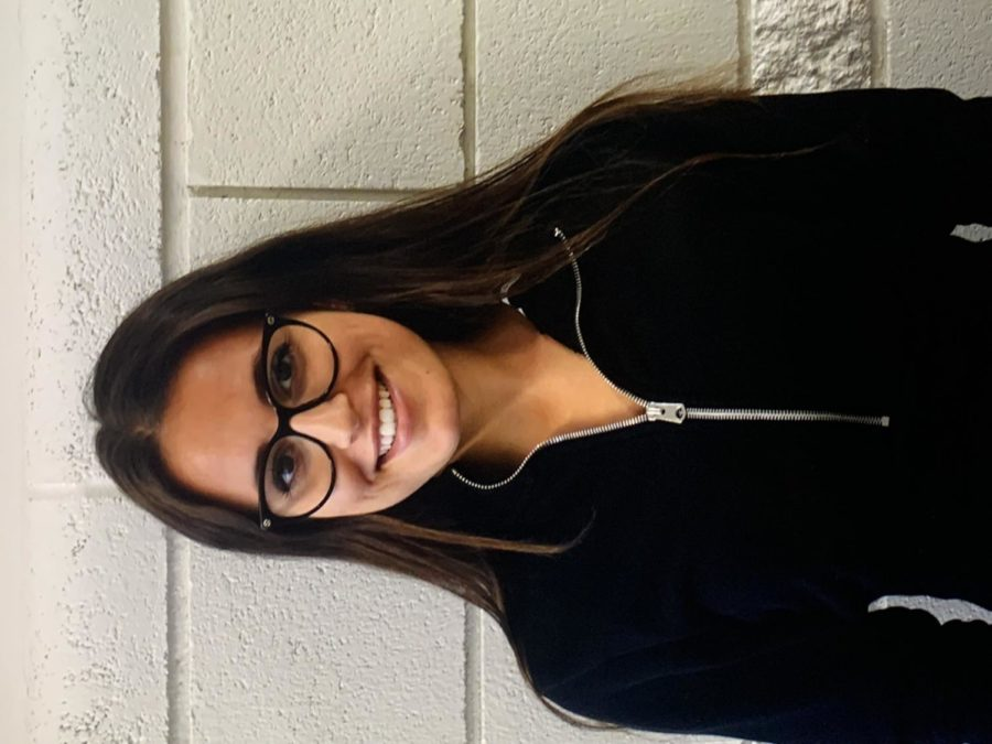 SMILE: Foreign exchange student, Irene Maione, poses for a picture in the hallway. She really enjoys the people and culture here in Star Valley.