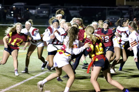 SET HUT: The junior girls run their play to try to score a touchdown. Powderpuff was such a blast! My favorite part of the game was being able to takedown my friend Kylee Erickson, said senior Gentry Hendricks.